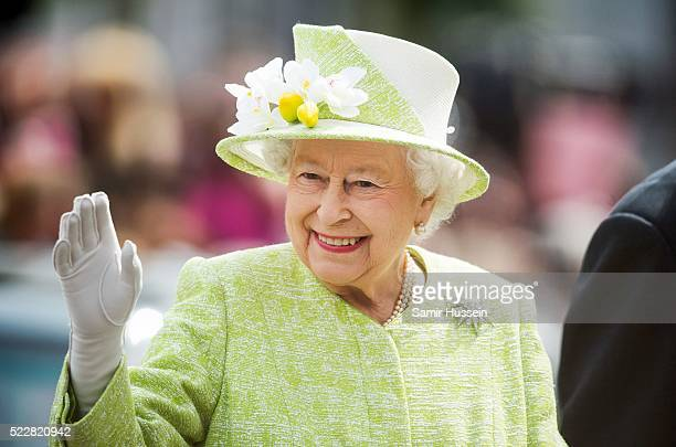 Queen Elizabeth II waves during a walk about around Windsor on her 90th Birthday on April 21 2016 in Windsor England