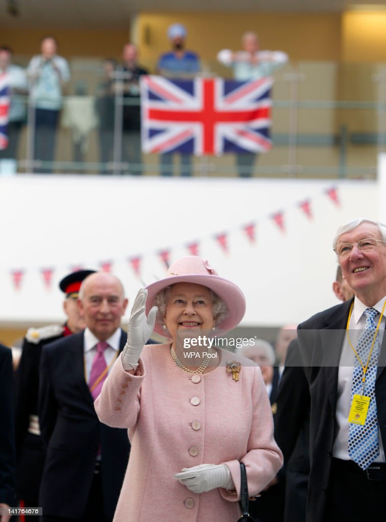 Queen <a gi-track='captionPersonalityLinkClicked' href=/galleries/search?phrase=Elizabeth+II&family=editorial&specificpeople=67226 ng-click='$event.stopPropagation()'>Elizabeth II</a> waves during the official opening of the Central Manchester City Hospitals on March 23, 2012 in Greater Manchester, north-west England. The Queen and the Duke of Edinburgh visited Manchester and officially opened hospitals, toured the new BBC building and officially started a Sport Relief Mile fun run.