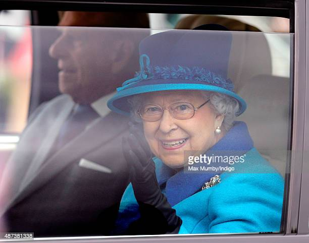 Queen Elizabeth II waves from her Range Rover car as she accompanied by Prince Philip Duke of Edinburgh opens the new Scottish Border's Railway...