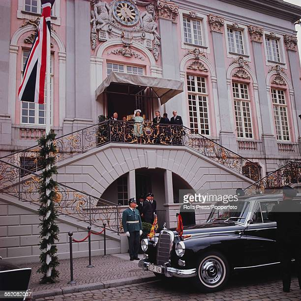 Queen Elizabeth II waves from the balcony at the top of a staircase in front of Bonn City Hall during an official state visit to West Germany on 15th...