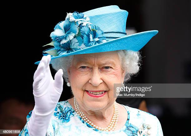 Queen Elizabeth II waves from the balcony of the Broadway Theatre during a day of engagements in the London Borough of Barking and Dagenham on July...