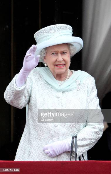 Queen Elizabeth II waves on the balcony of Buckingham Palace after the service of thanksgiving at StPaul's Cathedral on June 5 2012 in London England...