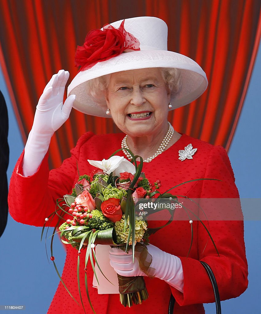 Queen Elizabeth II waves to some of the thousands of Canadian who turned out to celebrate Canada Day with her on Parliament Hill in Ottawa Ontario...