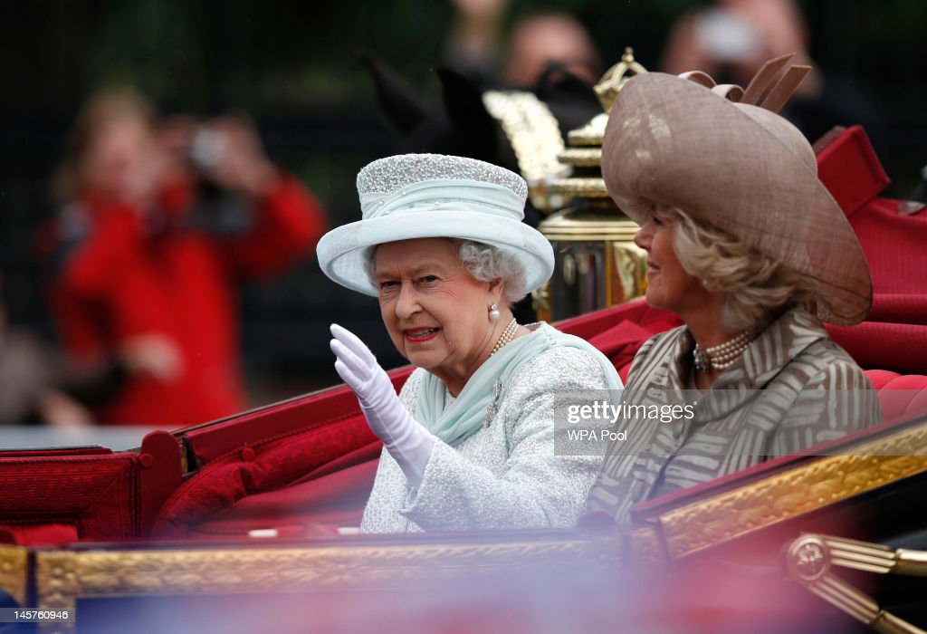 Queen Elizabeth II waves to spectators as Camilla, Duchess of Cornwall looks on as they Westminster Hall during the Diamond Jubilee celebrations on June 5, 2012 in London, England. For only the second time in its history the UK celebrates the Diamond Jubilee of a monarch. Her Majesty Queen Elizabeth II celebrates the 60th anniversary of her ascension to the throne today with a carriage procession and a service of thanksgiving at St Paul's Cathedral.