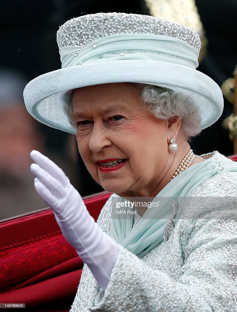 Queen Elizabeth II waves to spectators as she leaves Westminster Hall during the Diamond Jubilee celebrations on June 5, 2012 in London, England. For only the second time in its history the UK celebrates the Diamond Jubilee of a monarch. Her Majesty Queen Elizabeth II celebrates the 60th anniversary of her ascension to the throne today with a carriage procession and a service of thanksgiving at St Paul's Cathedral.