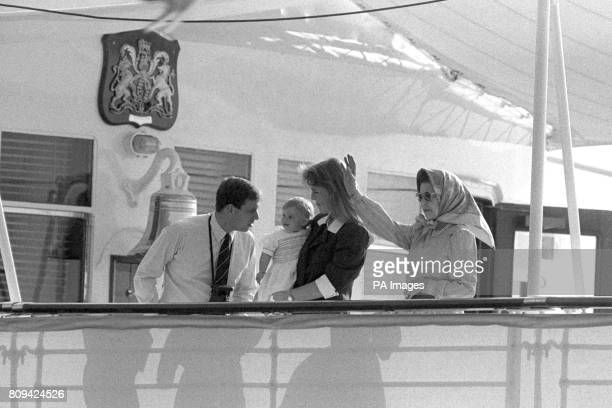 Queen Elizabeth II waves to the crowd ashore as she sails from Portsmouth in the Royal Yacht Britannia for a 10 day cruise of the Western Isles With...