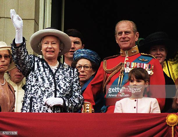 Queen Elizabeth II waves to the crowds as she stands on the balcony of Buckingham Palace with Prince Philip the Duke of Edinburgh Princess Margaret...
