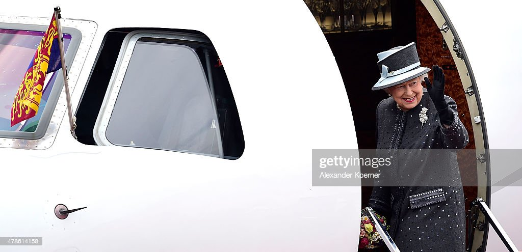 Queen Elizabeth II waves to the public while boarding an aircraft at the military airport of Celle on June 26, 2015 in Celle, Germany. The Royal couple visited the concentration camp memorial at Bergen-Belsen this morning. This is the final day of a four day state visit, which is their first to Germany since 2004.