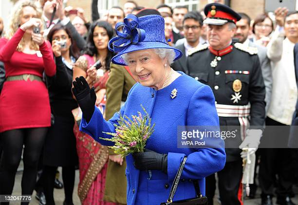 Queen Elizabeth II waves to wellwishers during a visit to Goodenough College to celebrate its 80th anniversary on November 10 2011 in London England