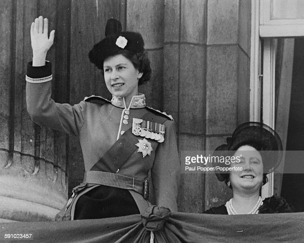 Queen Elizabeth II waving with the Queen Mother from the balcony of Buckingham Palace during her official birthday celebrations following the...