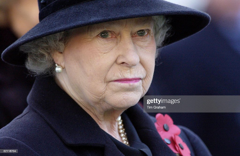 Queen Elizabeth II Wearing A Black Outfit For Mourning With Red Poppies And A Sad Expression Visiting The Field Of Remembrance At Westminster Abbey Commemorating The War Dead