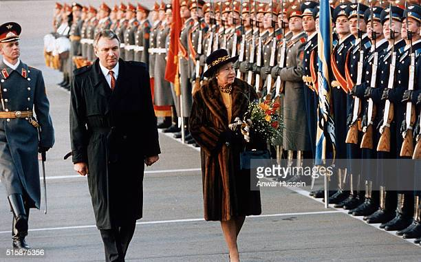 Queen Elizabeth II wearing a fur coat reviews the troops as she arrives in Moscow on October 17 1994 in Moscow Russia