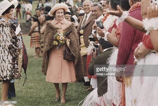 Queen Elizabeth II wearing a Maori fur cape during her visit to New Zealand 1977