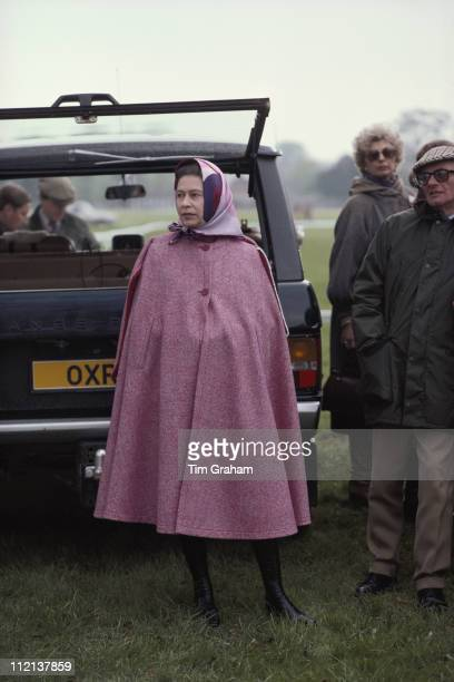 Queen Elizabeth II wearing a pink cape at the Royal Windsor Horse Show held at Home Park in Windsor Berkshire England Great Britain May 1979