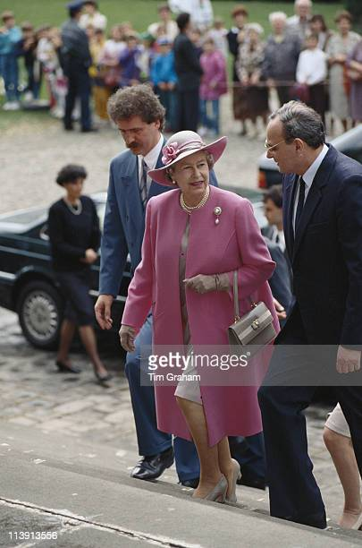 Queen Elizabeth II wearing a pink coat and matching hat on a walkabout in Budapest during a threeday state visit to Hungary 4 May 1993