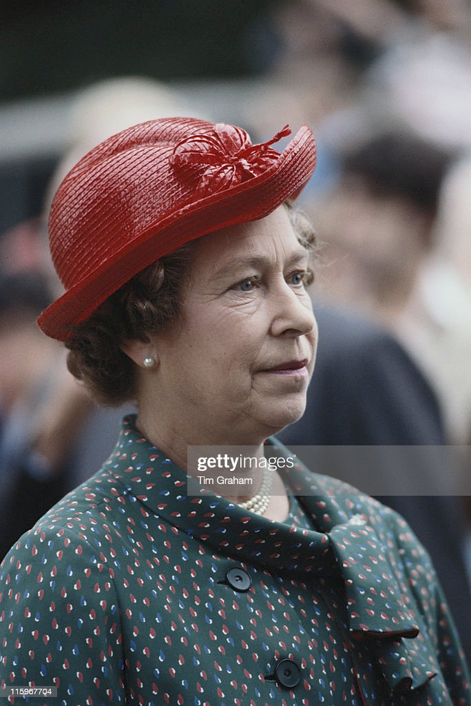 Queen Elizabeth II wearing a red hat designed by miliner Frederick Fox attending the Sandringham Flower Show on the Sandringham estate Norfolk...