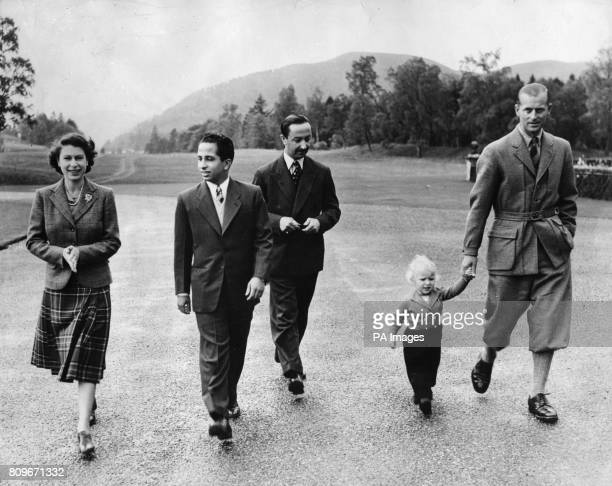 Queen Elizabeth II wearing a tartan skirt and tweed jacket outside Balmoral Castle with her Royal visitors King Faisal II and the Regent of Iraq the...