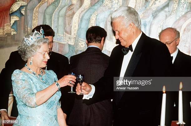 Queen Elizabeth II wearing a tiara attends a state banquet with Boris Yeltsin in 1994 in Moscow Russia