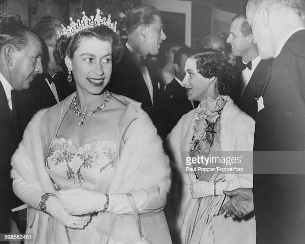 Queen Elizabeth II wearing an evening dress and tiara as she arrives at the Royal premiere of the film 'Neapolitan Fantasy' followed by Princess...