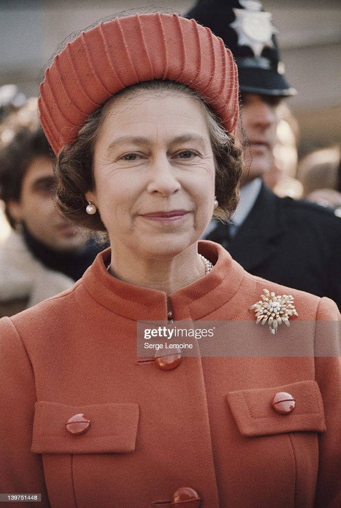 Queen Elizabeth II wearing an orange coat and hat, London, UK, circa 1977.