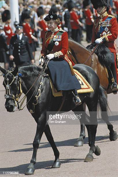 Queen Elizabeth II wearing ceremonial dress riding sidesaddle during the Trooping the Colour ceremony in London England Great Britain 14 June 1986...