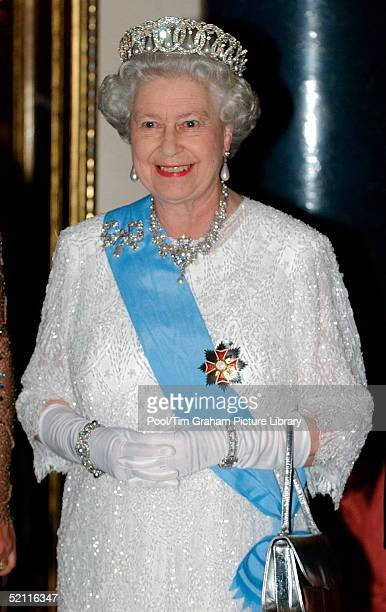 Queen Elizabeth II Wearing Decorations And Orders With Diamonds And Pearls At Buckingham Palace For A State Banquet