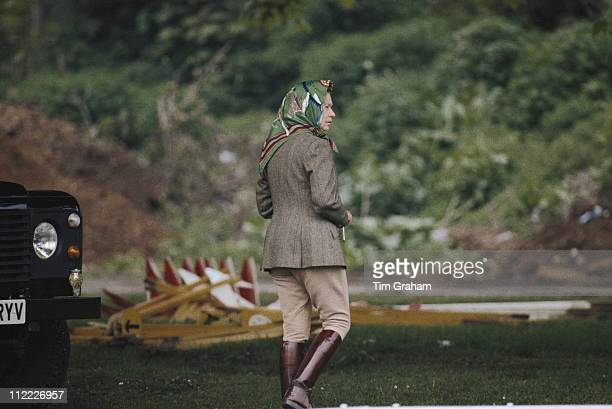 Queen Elizabeth II wearing jodhpurs and a headscarf while attending the Royal Windsor Horse Show held at Home Park in Windsor Berkshire England Great...