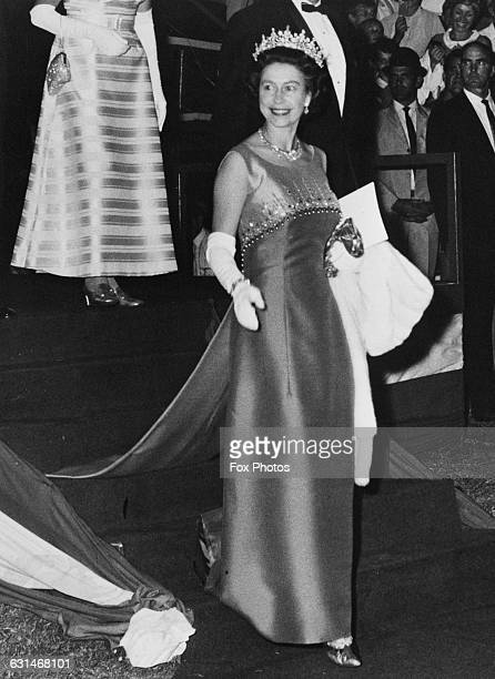 Queen Elizabeth II wears a satin evening dress with a jewelled bodice to a rodeo in the Queensland mining town of Mount Isa during her tour of...