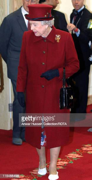 Queen Elizabeth II wears slippers when she visits a new Hindu Temple in Bradford on May 24 2007