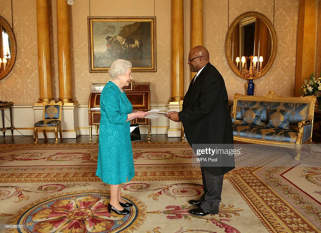 Queen Elizabeth II welcomes His Excellency Mr Thembinkosi Obed Mlaba from the Republic of South Africa during an audience where he presented the Letters of Recall of his predecessor and his own Letters of Credence as Ambassador at Buckingham Palace on May 29, 2014 in London, England.