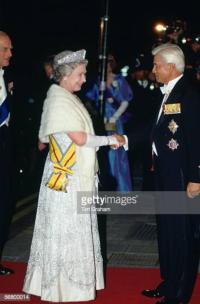 Queen Elizabeth II welcomes the Yang DiPertuan Agong of Malaysia to the Dorchester Hotel during his State Visit