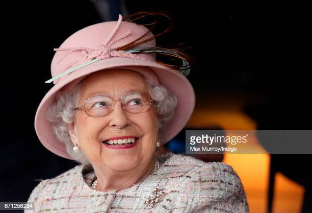 Queen Elizabeth II who celebrates her 91st birthday today watches the racing as she attends the Dubai Duty Free Spring Trials Meeting at Newbury...