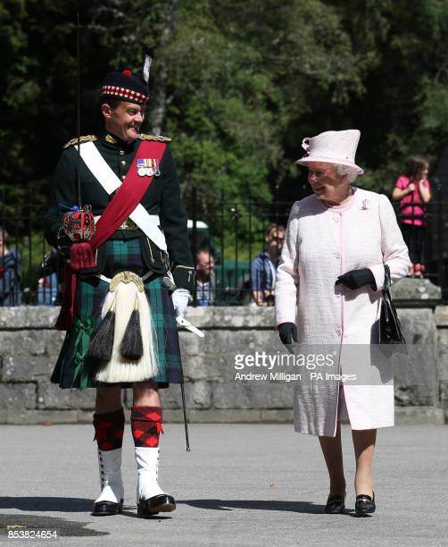 Queen Elizabeth II with Ballater Guard commanding officer Major Jason French as she inspects the Argyll and Sutherland Highlanders at the gates to...