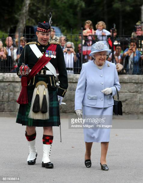 Queen Elizabeth II with Ballater Guard commanding officer Major Jules Kilpatrick as she inspects the Royal Scots Borderers at the gates to Balmoral...