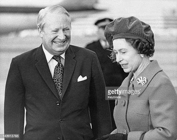 Queen Elizabeth II with British Prime Minister Edward Heath at Heathrow Airport London 28th January 1974 The Queen is about to take a flight to Canada