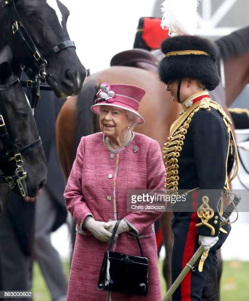 Queen Elizabeth II with Captain Halliwell as she reviewed the King's Troop Royal Horse Artillery during their 70th anniversary parade at Hyde Park on...