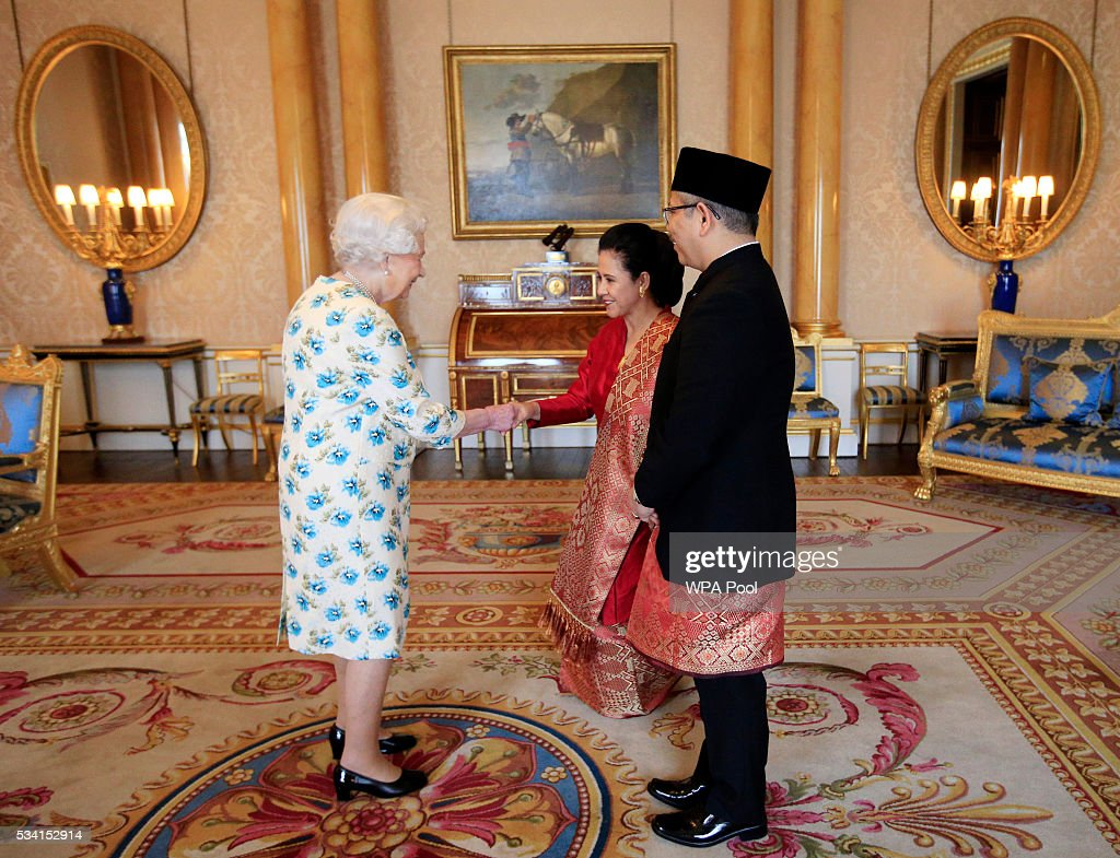 Queen <a gi-track='captionPersonalityLinkClicked' href=/galleries/search?phrase=Elizabeth+II&family=editorial&specificpeople=67226 ng-click='$event.stopPropagation()'>Elizabeth II</a> with Dr Rizal Sukma, the Ambassador from Indonesia, and his wife Hana Afija Satrijo after he presented his Letters of Credence during a private audience at Buckingham Palace on May 25, 2016 in London, England.