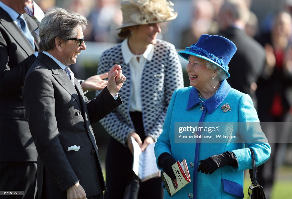 Queen Elizabeth II with her Bloodstock and Racing Advisor John Warren as they attend the Dubai Duty Free Spring Trials and Beer Festival at Newbury Racecourse in Newbury.
