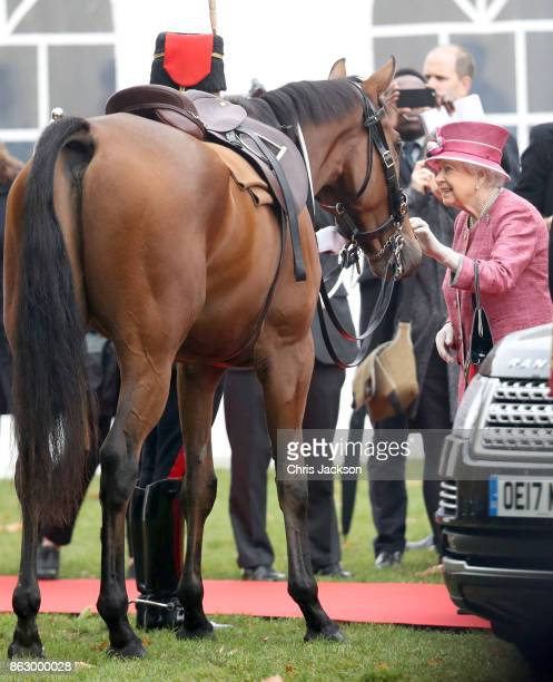Queen Elizabeth II with her horse called Knock the Brown One as she reviewed the King's Troop Royal Horse Artillery during their 70th anniversary...