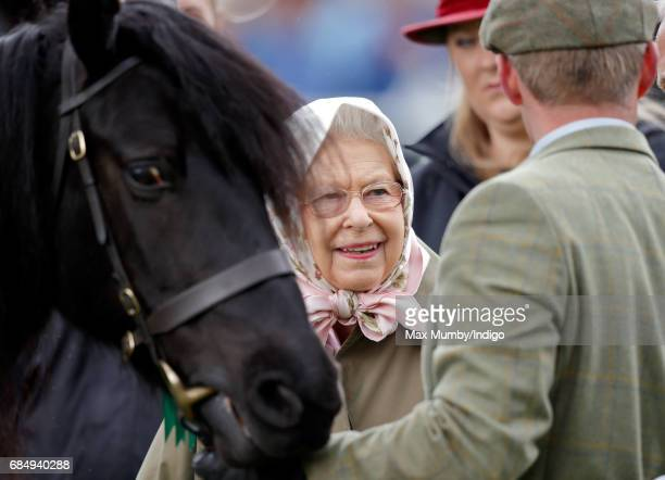 Queen Elizabeth II with her horse 'Murthwaite Dawn Chorus' which competed in the Fell Class on day 3 of the Royal Windsor Horse Show in Home Park on...