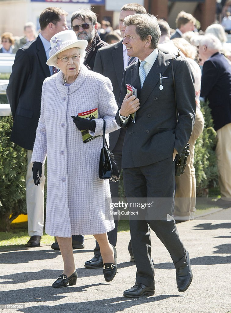Queen Elizabeth II with her racing manager John Warren attends The Dubai Duty Free New to Racing Day where she watched her horse 'Border Legend' in Race 3 'The Berry Bros & Rudd Magnum Spring Cup,' riden by Hayley Turner at Newbury Racecourse on April 20, 2013 in Newbury, England.
