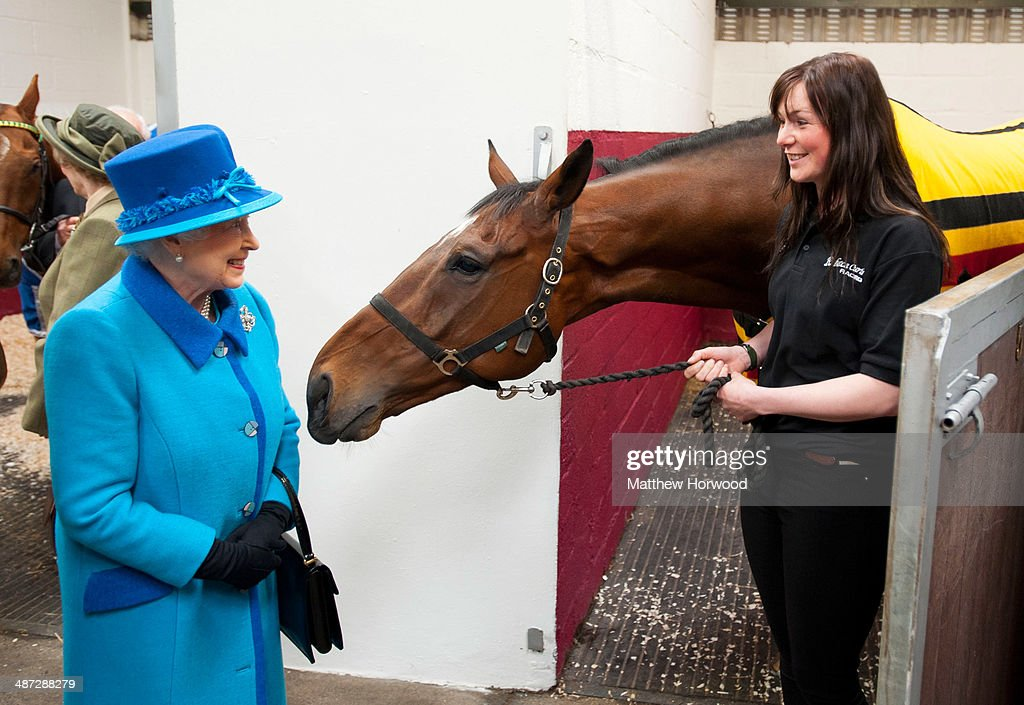 Queen Elizabeth II with horse Teaforthree and Rebecca Morris (R) of Cotts Farm Equine Hospital during an official visit to Cotts Farm Equine Hospital, Narbeth on April 29, 2014 in Narbeth, Wales. The Cotts Equine Hospital is a purpose-built facility offering veterinary equine care.