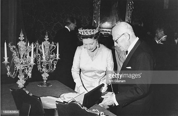 Queen Elizabeth II with Italian President Sandro Pertini at the Quirinale Palace during a visit to Rome 14th October 1980 They exchange gifts two...