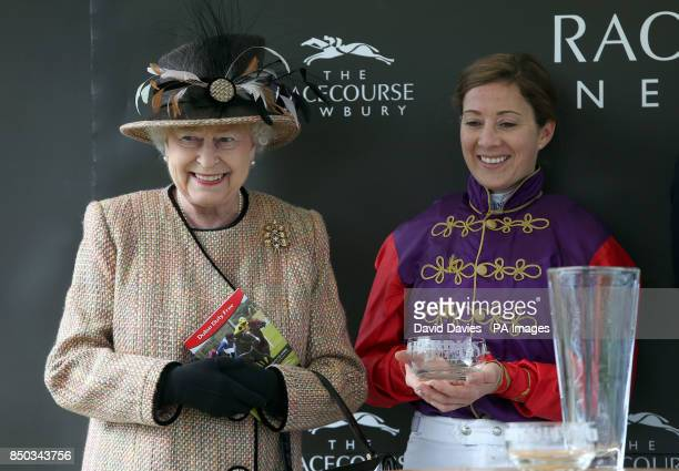 Queen Elizabeth II with jockey Hayley Turner after their victory in the Dreweatts 1759 Handicap during Dubai Duty Free Spring Trials Raceday at...
