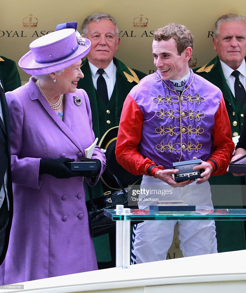 Queen Elizabeth II with jockey Ryan Moore as they celebrate winning The Gold Cup during Ladies' Day on day three of Royal Ascot at Ascot Racecourse on June 20, 2013 in Ascot, England.