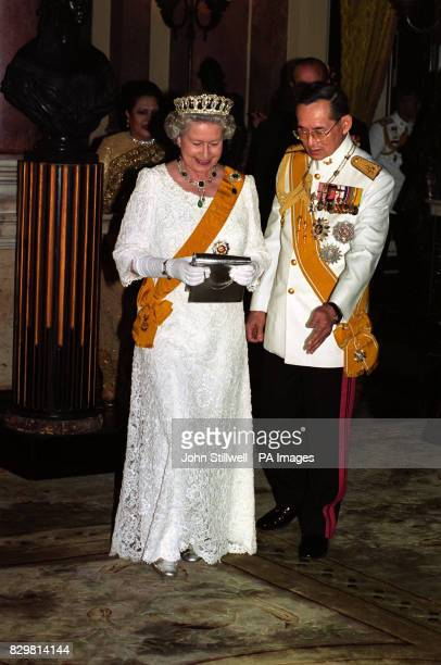 Queen Elizabeth II with King Bhumibol of Thailand at a state banquet in the Chakri Palace Throne Hall in Bangkok