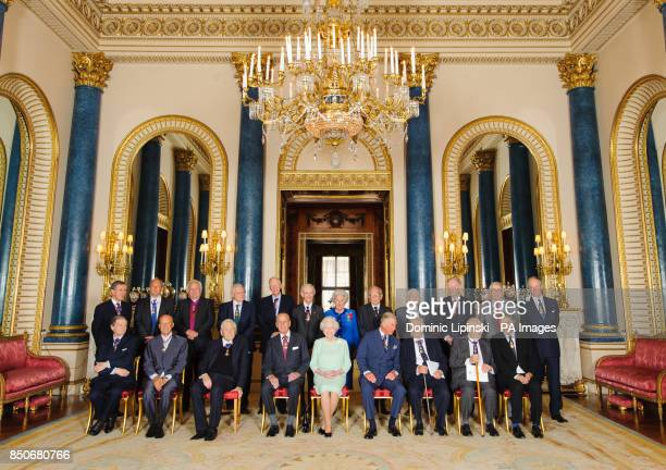 Queen Elizabeth II with members of the Order of Merit Professor Sir Roger Penrose Lord Foster of Thames Bank the Revd Professor Owen Chadwick the...