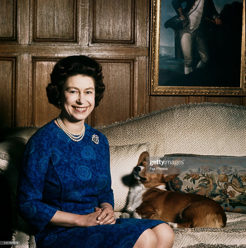 Queen Elizabeth II with one of her corgis at Sandringham, 1970.