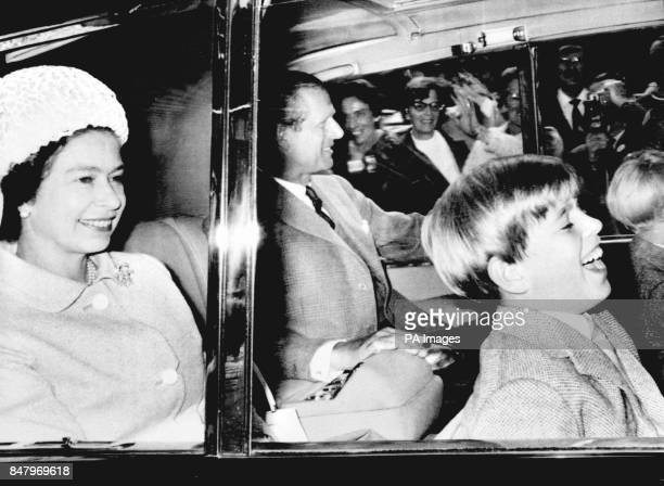Queen Elizabeth II with Prince Andrew and the Duke of Edinburgh as they drive away from Crathie Parish Church on Deeside after attending morning...