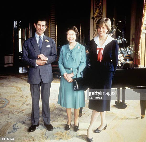Queen Elizabeth II with Prince Charles and his fiancee Lady Diana Spencer at Buckingham Palace 27th March 1981